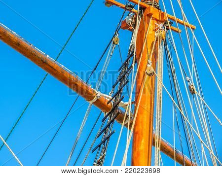 Mast of the ancient sailing ship on the blue sky background