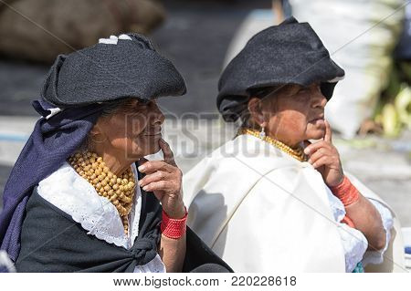 Otavalo, Ecuador-December 23, 2017: indigenous quechua women wearing traditional clothing in the Saturday market