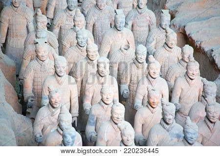 XIAN, CHINA - October 8, 2017: Famous Terracotta Army in Xi'an, China. The mausoleum of Qin Shi Huang, the first Emperor of China contains collection of terracotta sculptures depicting men and horses.