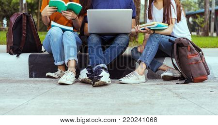 Students university asian together study smiling with tablet,laptop computer at university high school campus,college in summer holiday relaxation