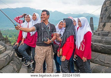 JAVA, INDONESIA - DECEMBER 16, 2016: Making a selfie during visiting Prambanan or Candi Rara Jonggrang, a Hindu temple compound in Java, Indonesia, on the 16th december 2016