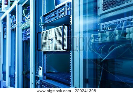 Many racks with servers located in the server room. Bright display a plurality of operating equipment