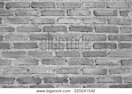 White or grey background with brick wall textured.