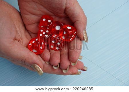 red game blocks in a pile on the open palms of hands