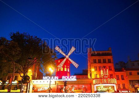 PARIS, FRANCE - APRIL: The Moulin Rouge in evening. Moulin Rouge is a famous cabaret built in 1889, locating in the Paris red-light district of Pigalle