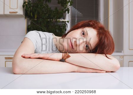 Tired Ginger Housewife Takes Nap, Leans Head On Hands, Being Fatigue After Cleaning Kitchen, Closes