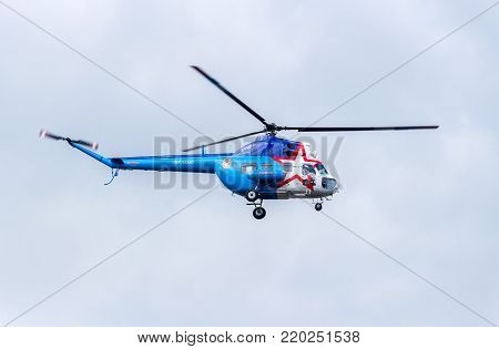 Samara, Russia - September 10, 2017: Russian Air Force Mi-2 helicopter flying against cloudy sky