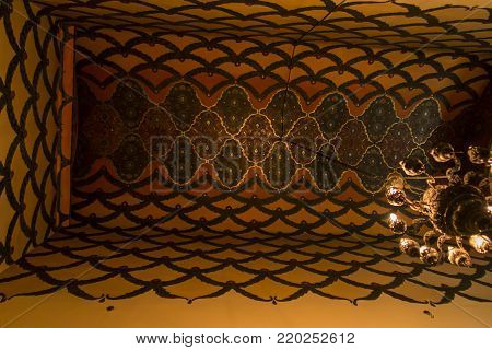 VAGHARSHAPAT, ARMENIA - SEPTEMBER 17, 2017: The decor of the main entrance to Etchmiadzin Mother Cathedral, includes gilt relief Byzantine patterns