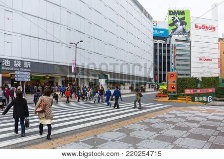 TOKYO, JAPAN - NOVEMBER 14, 2016: Streets of Ikebukuro district of Tokyo metropolis, Japan. Tokyo Metropolis is both the capital and most populous city of Japan.