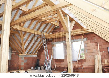 Unfinished House Attic Construction Interior. Building house attic room with roofing wood trusses, frame, wooden beams. poster