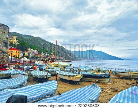Fishing boats in cloudy weather on the beach of Laigueglia, Savona, Liguria, Ligurian Sea, Italy.