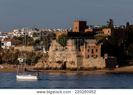 Ferragudo, Portugal, August 19, 2017: Fort of Sao Joao do Arade (Castle of Arade), a medieval fortification, situated in a dominant position to guard the estuary and mouth of the Arade river.
