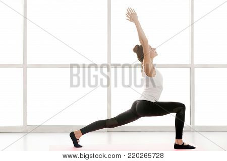 Anonymous Woman Sitting In Lotus Posture, Doing Yoga
