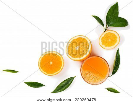 Top view of orange slices and juice isolated on white background.