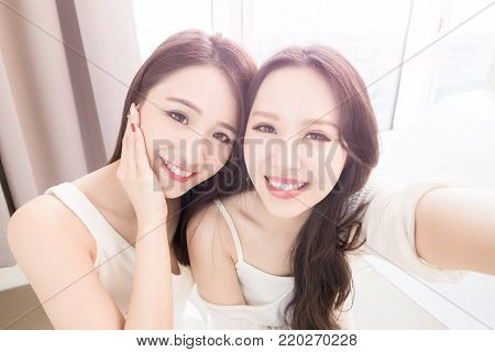 two beauty woman selfie happily in the home