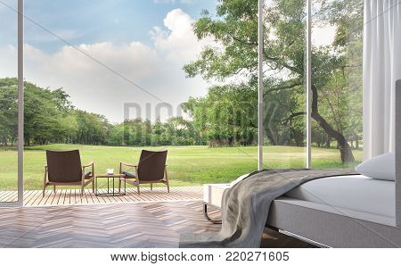 Modern bedroom with garden view 3d rendering image.The Rooms have wooden floors ,There are large open doors. Overlooks wooden terrace and large garden.