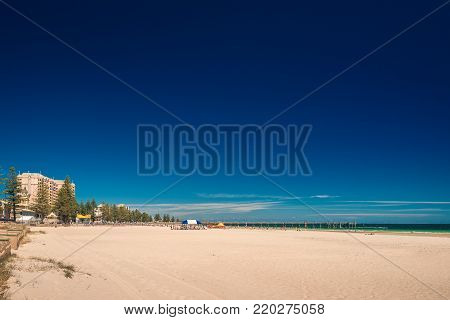 People at Glenelg beach on a bright summer day
