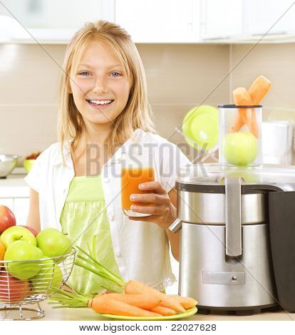 Happy Girl drinking fresh carrot and apple juice. Juice Extractor. poster