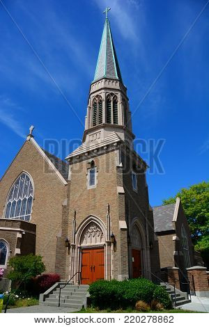 Gothic Church in Bellingham, WA with blue sky and wispy clouds