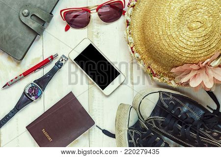 Top view of Traveler's accessories, Essential vacation items, Travel concept background