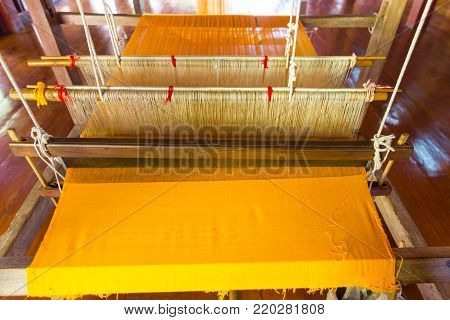 Household weaving - Detail of weaving loom for homemade silk or textile production of Thailand