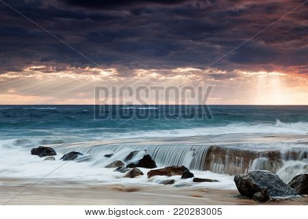 Sun Rays Breaking Through Storm Clouds Over The Port Noarlunga Boat Ramp