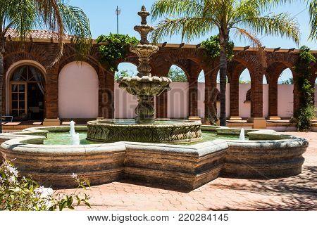 ENSENADA, MEXICO - MAY 3, 2017:  Fountain of the hacienda style Adobe Guadalupe Winery and Inn in Baja California's Valle de Guadalupe, near the town of El Porvenir.