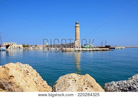 RETHYMNO, CRETE - SEPTEMBER 15, 2016 - View of the harbour and lighthouse with the castle to the rear, Rethymno, Crete, Greece, Europe, September 15, 2016.