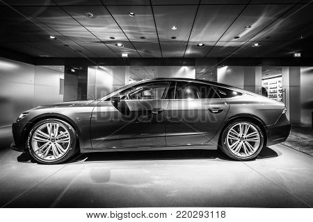 BERLIN - DECEMBER 21, 2017: Showroom. Mid-size luxury car Audi A7 Sportback 55 TFSI quattro. Since 2017. Black and white.