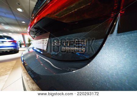 BERLIN - DECEMBER 21, 2017: Showroom. Emblem of the mid-size luxury car Audi A7 Sportback 55 TFSI quattro. Since 2017.