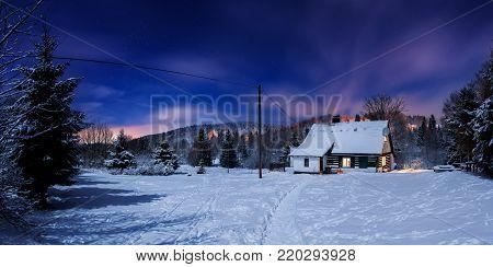 Cottage the name Divenka, Horni Maxov, Czech Republic, Europe - December 29, 2017: Moonlight view on Cottage the name Divenka in Jizera Mountains.