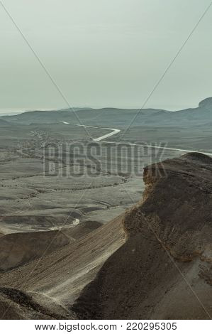 View on desert judean land and sky near dead sea in Israel. Valley of sand, mountains and stones in hot middle east tourism place. Scenic outdoor infinity on wild land.