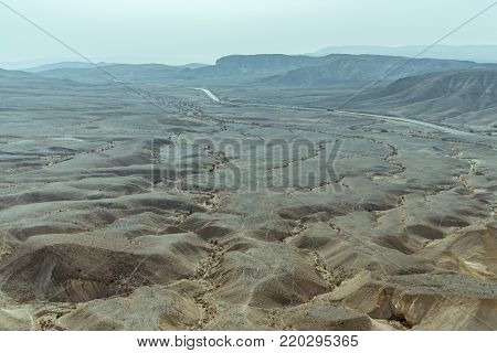 Sunny landscape view of dry desert near the dead sea in Israel. Infinity valley panorama of lone sand, rocks, hills and stones. Waterless middle east territory, silence and heat.