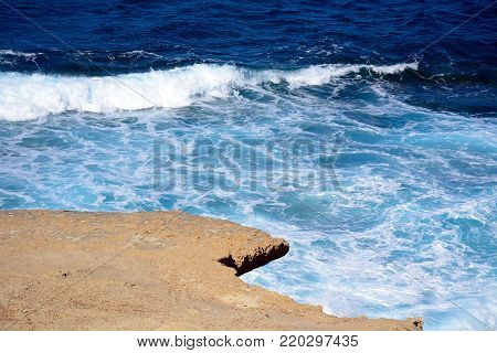 Rugged rocks overhanging the sea, Redoubt, Marsalforn, Gozo, Malta, Europe.