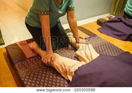 Massage Background Body Massage In Spa Salon Young Woman Expressive Relaxation. Image For Body Care,