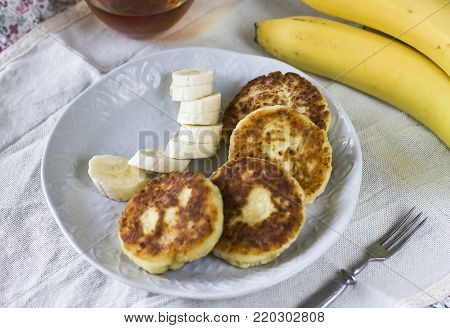 Cottage cheese pancakes with banana slices. Healthy breakfast
