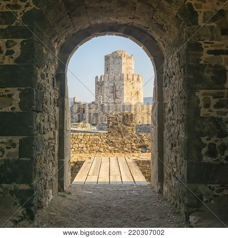Methoni, Greece 9 August 2017. Methoni castle framed from a door.
