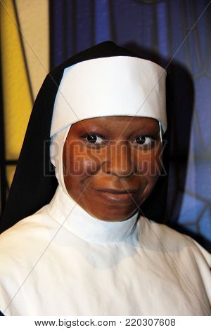 London, - United Kingdom, 08, July 2014. Madame Tussauds in London. Waxwork statue of Whoopie Goldberg dressed as a nun for the movie Sister Act