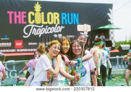 Chengdu, China - July 2, 2016 : Chinese girls taking selfie at the Chengdu Color Run