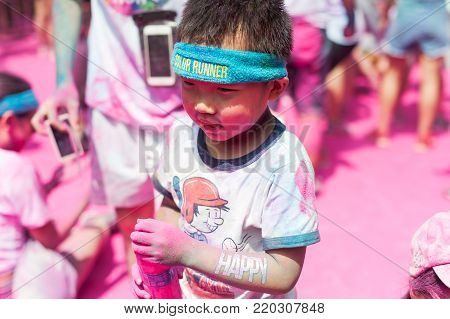 Chengdu, China - July 2, 2016 : Little boy enjoying the Chengdu color run