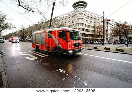 BERLIN - DECEMBER 21, 2017: Rescue vehicles are rushing to the rescue. Kurfurstendamm. Motion blur.