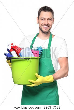 Young professional with cleaning supplies, isolated on white