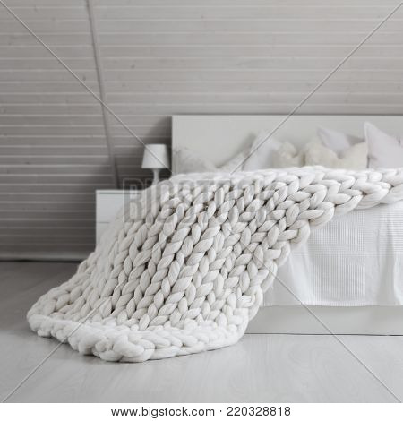 White Nordic Bedroom Interior With Knit Plaid