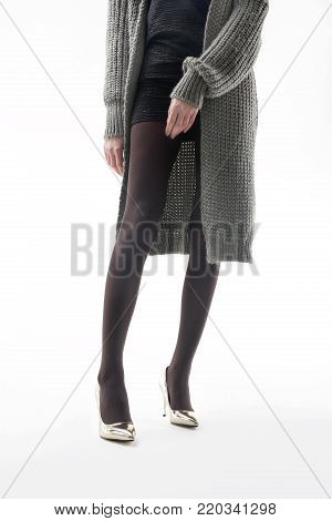 Winter tights. Beautiful and shapely legs of a woman in opaque tights.