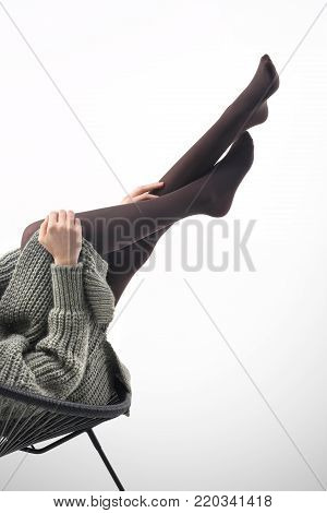 Warm tights. Legs of a woman in pantyhose