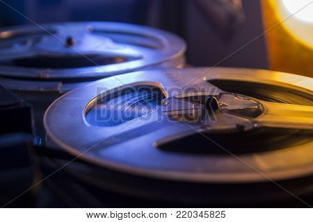 Vintage tape recorder is playing music, close up