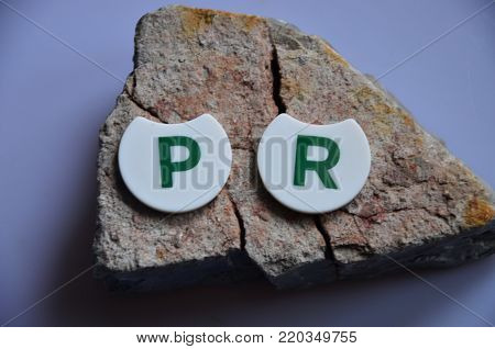 word pr on an   abstract colored  background