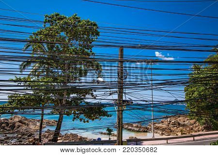 Electricity cables in Phuket , Thailand. Close up on the electricity pillar and cable intersections.