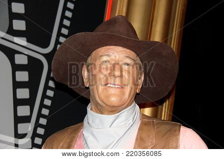 London, - United Kingdom, 08, July 2014. Madame Tussauds in London. Waxwork statue of John Wayne.