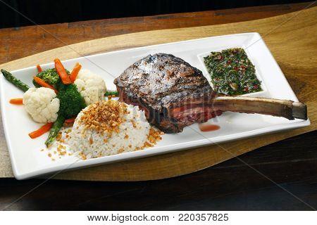 Tomahawk rib beef steak with rice and salad